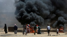 Palestinians protest on the Israel/Gaza border.