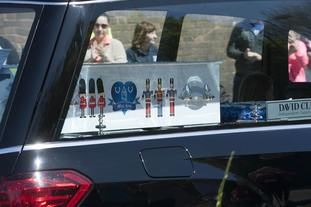 Alfie's coffin was decorated with toy soldiers and an Everton-style badge.