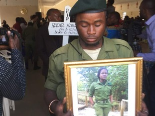 Mourners attending Ms Baraka's funeral pay their respects to the ranger who died in the line of duty.