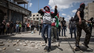 Palestinian protesters clash with Israeli security forces in the West Bank city of Ramallah.