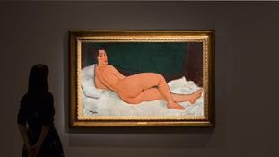 'Mesmerising' Modigliani masterpiece fetches $157m (£116m) at auction
