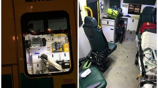 Vandals smash ambulance window as paramedics treat sick child inside