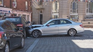 The car hit a pedestrian before colliding with two other cars