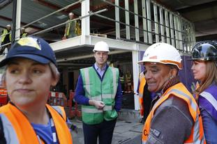 The Prince spoke with community members and construction workers at the site in Ladbroke Grove.