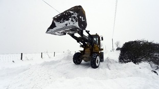 Shovelling snow in Tanfield County, Durham.