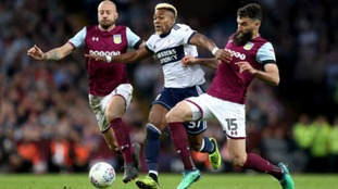 Mile Jedinak and Alan Hutton battle with Middlesbrough's Adama Traore