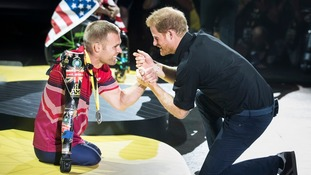 Prince Harry presenting Mark Ormrod with silver at the Invictus Games in Canada.