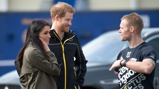 Prince Harry introduces his bride-to-be Meghan Markle to Mark Ormrod at the Invictus trials in Bath.