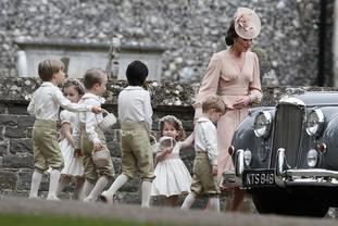 The Duchess of Cambridge with Prince George and Princess Charlotte at Pippa Middleton's wedding to James Matthews.