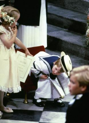 Six year-old Laura Fellowes points at her cousin Prince William at the Duke of York's wedding.