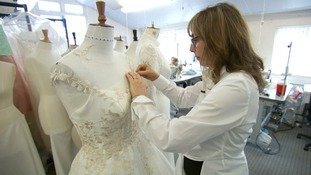 Sassi Holford working on a dress