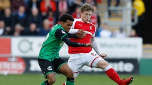 Scunthorpe United's Duane Holmes (left) and Rotherham United's Matt Palmer battle for the ball