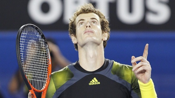Andy Murray celebrates defeating Roger Federer in the Australian Open