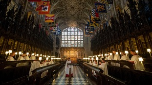 A choir rehearses at St George's Chapel where the ceremony will be held.