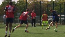 Mike Phelan coaching a future generation of footballers in Peterborough.