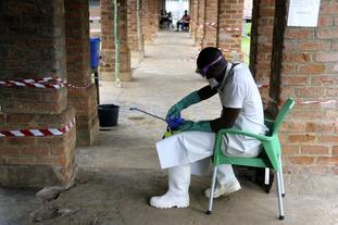 A health care worker wears virus protective gear at a treatment centre in Bikoro, Democratic Republic of Congo