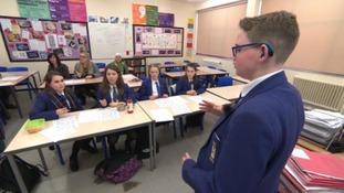 Reuben teaching sign language to his fellow pupils.