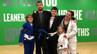 Chris and Gina Hopkins with some of the Adaptive Martial Arts group.