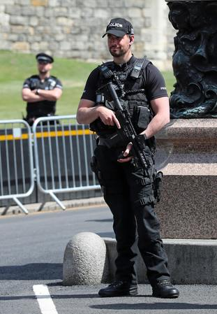 Armed police outside Windsor Castle ahead of the wedding of Prince Harry and Meghan Markle on Saturday (Steve Parsons/PA)