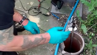 Chimney sweep helps rescue tiny kittens trapped in an underground pipe