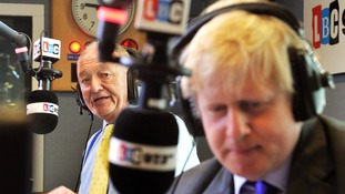 The incumbent and current Mayor of London Boris Johnson (foreground) in discussion with rival candidate Ken Livingstone