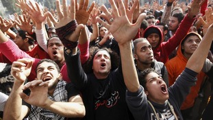 Al-Ahly fans, also known as Ultras, celebrate the death sentences, outside their club in Cairo.