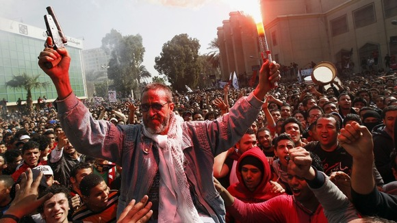 The father of an Al-Ahly fan who was killed in Port Said celebrates with fans in Cairo