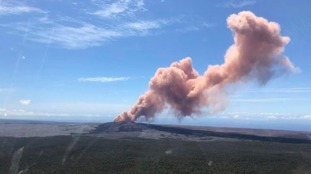 Red ash rises from the Puu Oo vent on Hawaii's Kilauea volcano after an earthquake struck the Big Island.