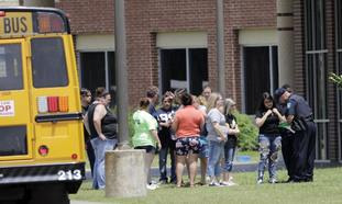 Students are checked before entering Santa Fe High School