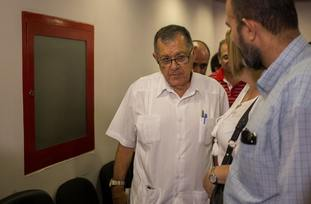 Cuban Transport Minister Adel Yzquierdo leaves after speaking to reporters on the island nation's worst aviation disaster in three decades