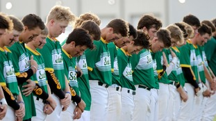 Santa Fe High School baseball players hold a minute's silence before a game on Saturday.