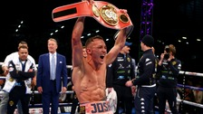 Josh Warrington celebrates with the IBF featherweight belt after beating Lee Selby