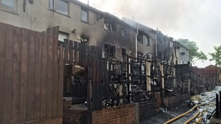 The charred remains of homes destroyed by fire in Newtownabbey