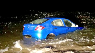 Driver watches in horror as high tides threaten to wash car out to sea