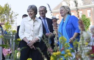 Prime Minister Theresa May, accompanied by her husband Philip.