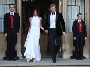 The newly married Duke and Duchess of Sussex, Meghan Markle and Prince Harry leave Windsor Castle to attend an evening reception at Frogmore House.