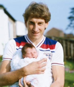 Former England football captain Terry Butcher pictured with Christopher when he was a baby.