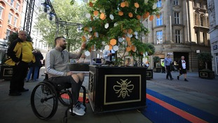 Martin Hibbertt who was injured in the attack reads messages on one of the Trees of Hope.
