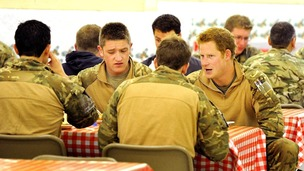 Prince Harry with fellow air crew in the DFAC (Dining Facility)