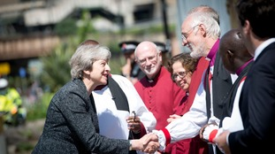 The Prime Minister is greeted by Bishop of Manchester David Walker