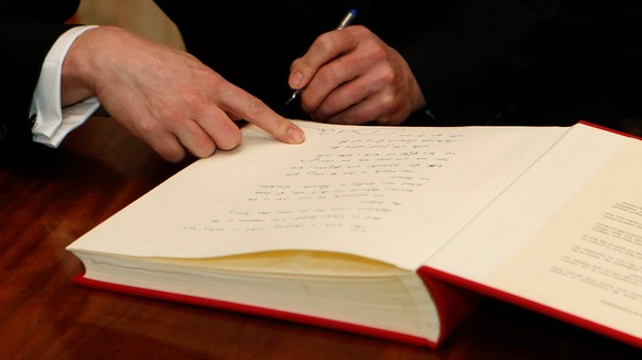 David Cameron signs the Book of Commitment ahead of Holocaust Memorial Day