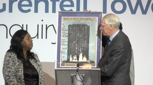 Sir Martin was presented with a painting of the Grenfell Tower's burnt-out shell