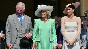 The Prince of Wales with the Duchess of Cornwall and the new Duchess of Sussex.