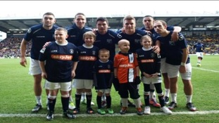 Cory Davidson (pictured in the Orange strip)with some of the Luton Town players