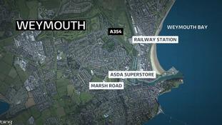 Man 54 arrested after shots fired near supermarket