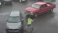 Sledgehammer road rage attack caught on camera