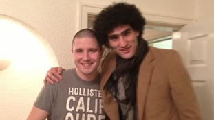 Maroaune Fellaini scored a spot in the Kop thanks to Liverpool fan Paul Feeney, left.