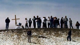 1999: Mourners gather on top of a hill overlooking Columbine High School.