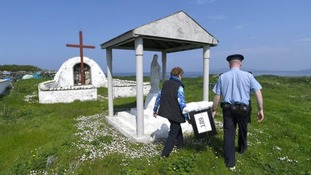 Garda Alan Gallagher and Presiding Officer Carmel McBride carry a polling box used by the few people that live off the coast of Donegal on the island of Inishbofin