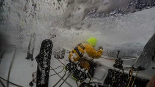On board Team AkzoNobel, Chris Nicholson eases the sails